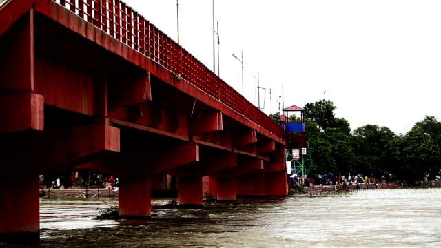 bridge and ganges river, haridwar india - acqua santa video stock e b–roll