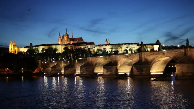 WS Bridge and Hradcany Castle illuminated at dusk / Prague, Czech Republic