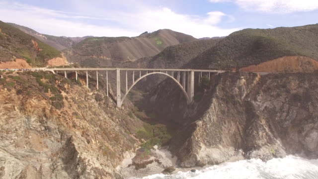 bridge arch ocean fly under aerial, 4k, stock video sale - drone discoveries llc -drone aerial video california coast with bridges, marina, boats and kayaking, 4k transportation - arch bridge stock videos & royalty-free footage