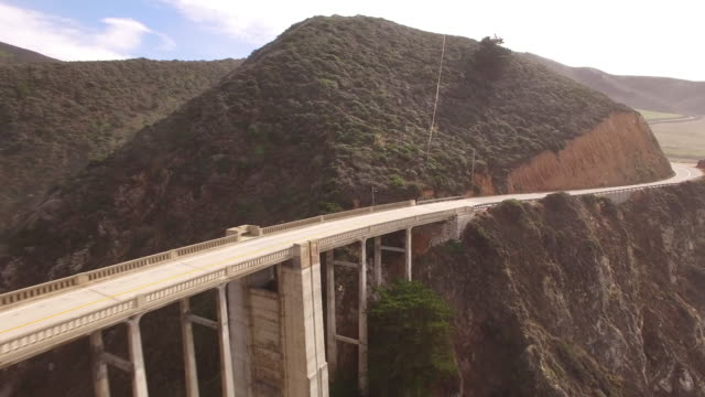 bridge arch reveal fly under aerial, 4k, stock video sale - drone discoveries llc -drone aerial video california coast with bridges, marina, boats and kayaking, 4k transportation - arch bridge stock videos & royalty-free footage