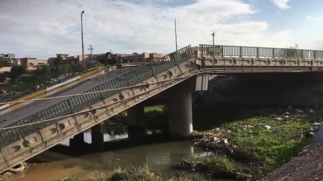 A bridge collapsed in Mosul Iraq on March 26 2017 Iraqi Army and Peshmerga members take part in the operation to retake Mosul from Daesh terrorists...