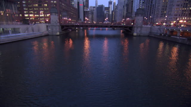 a bridge crosses the chicago river at michigan avenue. - michigan avenue bridge stock videos and b-roll footage