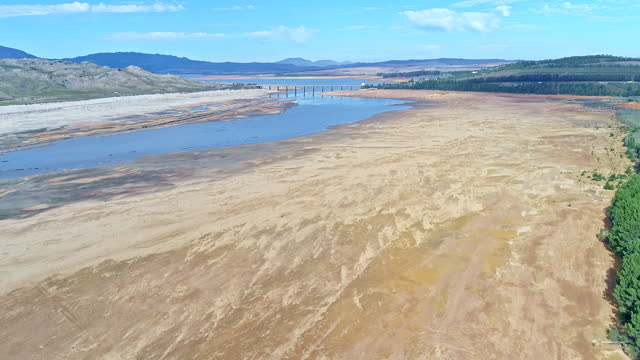 bridge crossing over the ever receding water levels of the theewaterskloof dam in a drought - climate change stock videos & royalty-free footage