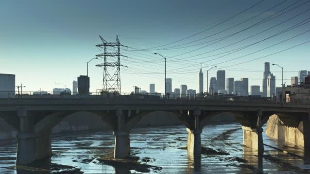 Bridge Crossing LA River in Vernon, California - Ascending Drone Shot