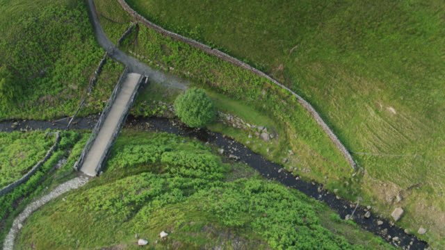 bridge crossing stream in pennines - aerial - lancashire stock videos & royalty-free footage