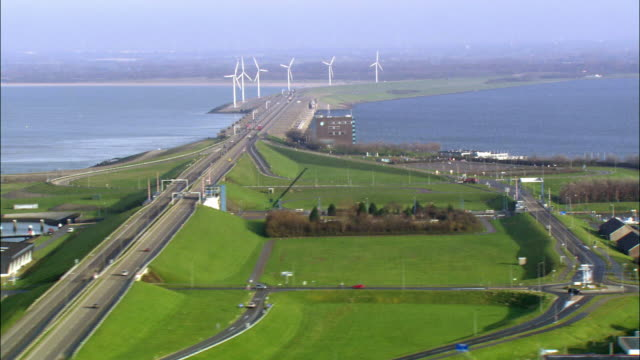 low aerial, bridge crossing wind mill farm, netherlands - holland stock videos and b-roll footage