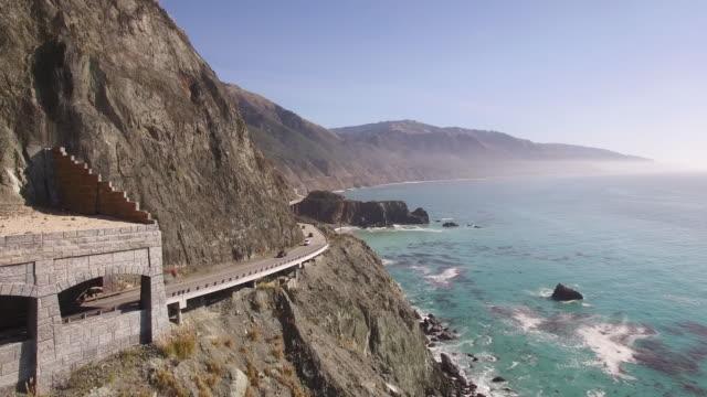 stockvideo's en b-roll-footage met bridge end push aerial, 4k, stock video sale - drone discoveries llc - 4k drone aerial video of california coastline bridge - sale