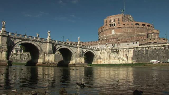 la bridge leading to the castel sant'angelo / rome, lazio, italy - low angle view video stock e b–roll
