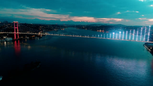 bridge of istanbul bosphorus at sunrise (july 15 martyrs' bridge) 4k - ponte video stock e b–roll
