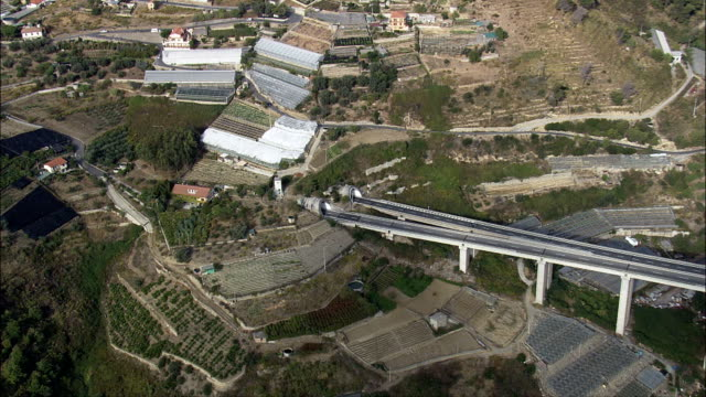 bridge on e80 at casa serena  - aerial view - liguria, provincia di imperia, san remo, italy - exit sign stock videos & royalty-free footage