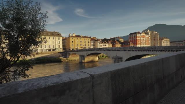 bridge over drac river - grenoble, france - grenoble stock-videos und b-roll-filmmaterial