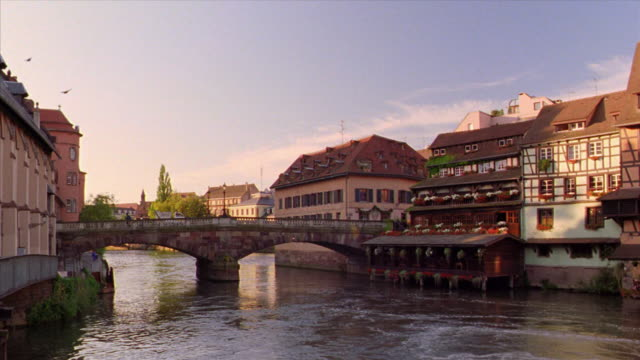 PAN bridge over Ill River lined by houses / Strasbourg, Alsace, France