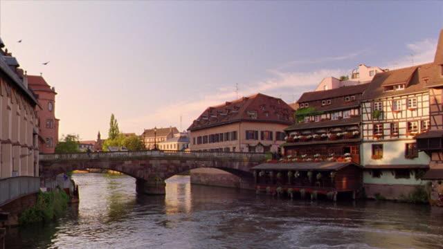 vidéos et rushes de pan bridge over ill river lined by houses / strasbourg, alsace, france - strasbourg