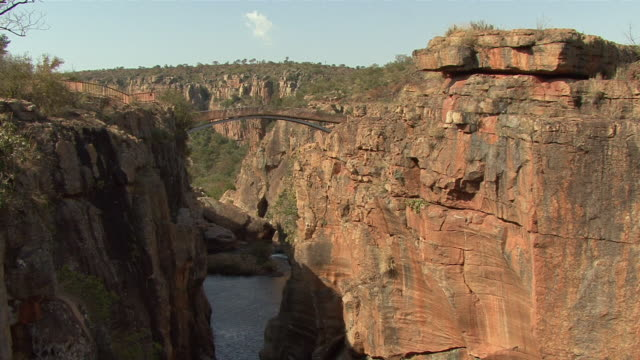 ws bridge over river in blyde river canyon / mpumalanga province, south africa - mpumalanga province stock videos and b-roll footage