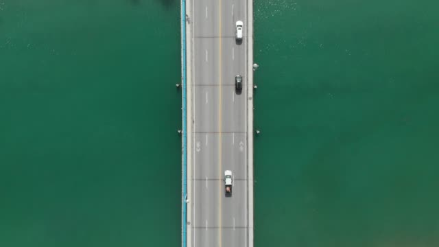 bridge over river water from directly above - above stock videos & royalty-free footage