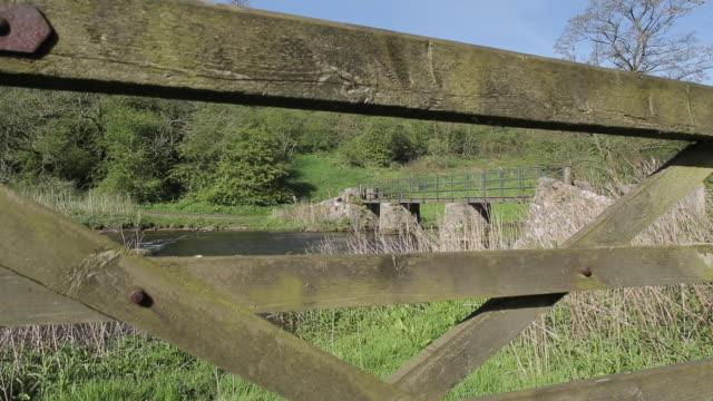 bridge over river wye, monsal dale, derbyshire, england, uk, europe - derbyshire stock videos & royalty-free footage