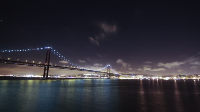 bridge over tejo river time lapse - lisbon stock videos and b-roll footage