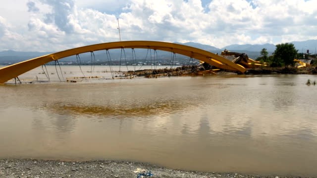 a bridge sits destroyed after being hit by an earthquake and tsunami on october 02 2018 in palu indonesia indonesias disaster response agency... - indonesia earthquake stock videos & royalty-free footage