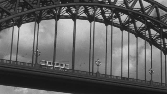montage bridge spanning the river tyne / united kingdom - tyne bridge stock videos & royalty-free footage