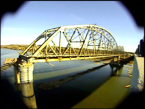 ws bridge supports collapse and bridge falls into water in a large cloud of dust and smoke / bismarck, north dakota, united states - bismarck north dakota stock videos & royalty-free footage