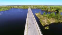 bridge through  beautiful river in  bright day. Aerial