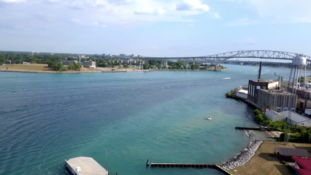 bridge to canada over the st. clair river in port huron michigan on lake michigan - michigan stock videos & royalty-free footage