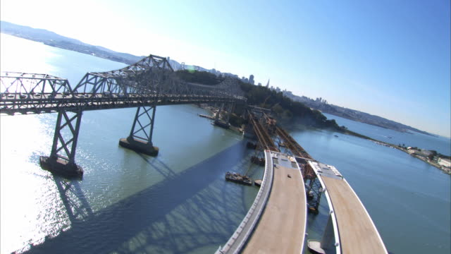 AERIAL Bridge under construction and traffic on eastern span replacement of Oakland Bay Bridge / California, USA