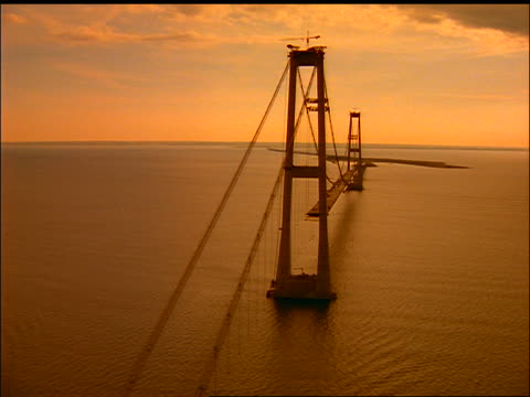 AERIAL bridge under construction over water at sunset / Store Baelt (East Bridge), Nyborg, Fyn