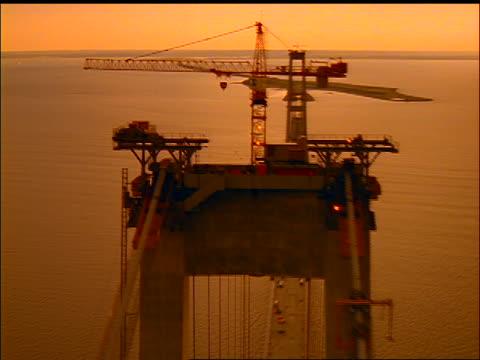 AERIAL bridge under construction over water at sunset / Store Baelt (East Bridge), Nyborg, Fyn