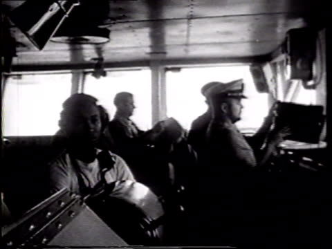 WS Bridge w/ Captain James Holloway III sitting in front of window MS Navigator SOT calling com suggesting course VS Officers on bridge many in early...
