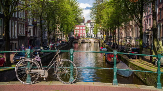 bridge with bicycle in amsterdam, netherlands - 4k cityscapes, landscapes & establishers - canal stock videos & royalty-free footage