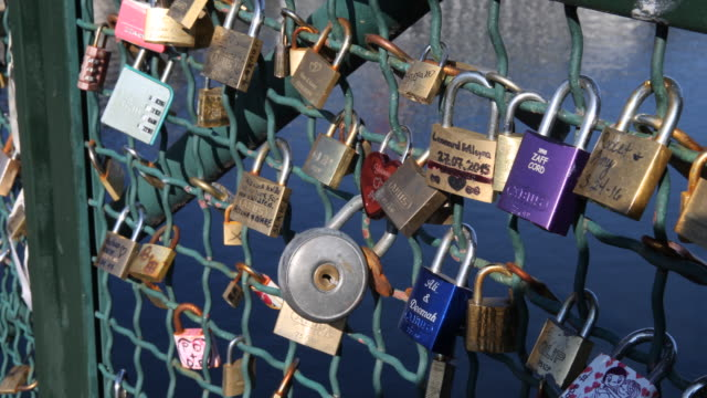 Bridge with love locks over the river Limmat in Zurich