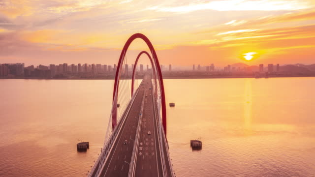 bridge with sunrise,hyper lapse - hangzhou stock videos & royalty-free footage