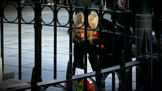 bridgend ext debra morris mother of lance corporal dane elson who was killed on duty in afghanistan laying wreath at memorial and voiceover sot his... - remembrance sunday stock videos & royalty-free footage