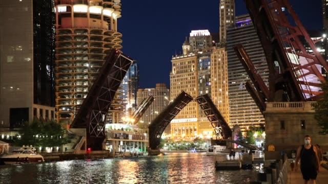 bridges across the chicago river are raised to control access into downtown after widespread looting broke out early monday in the city on august 12,... - looting stock videos & royalty-free footage
