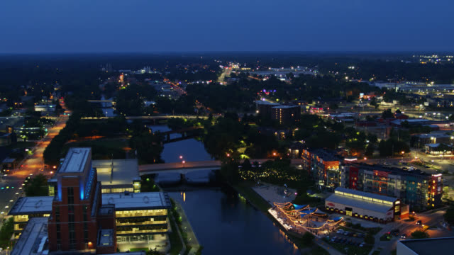 bridges crisscrossing the grand river in lansin, michigan at twilight - aerial - lansing stock videos & royalty-free footage