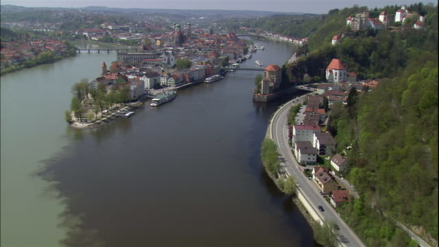 bridges cross the danbue, inn and ilz rivers in passau, bavaria, germany. - river danube video stock e b–roll