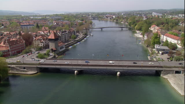 bridges cross the rhine river through the small city of konstanz, baden wurttemberg, germany. - baden wurttemberg stock videos and b-roll footage