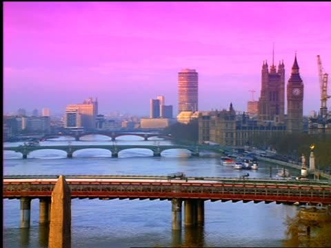 violet bridges on thames river / train passing over lambeth railraod bridge / london, england - 1999 stock videos & royalty-free footage