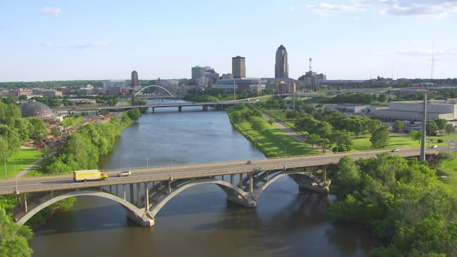 WS AERIAL POV Bridges over river in city / Des Moines, Iowa, United States