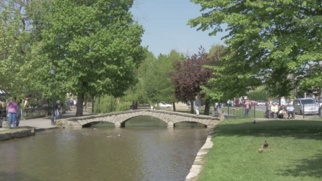 bridges over river windrush, bourton on the water, cotswolds, gloucestershire, england, united kingdom, europe - windrush river stock videos and b-roll footage
