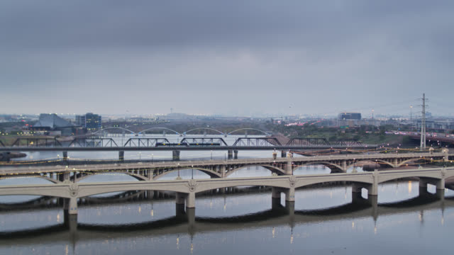 bridges over still water in tempe, arizona at sunrise - arizona stock-videos und b-roll-filmmaterial