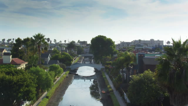 bridges over venice canals, california - drone shot - canal stock videos & royalty-free footage
