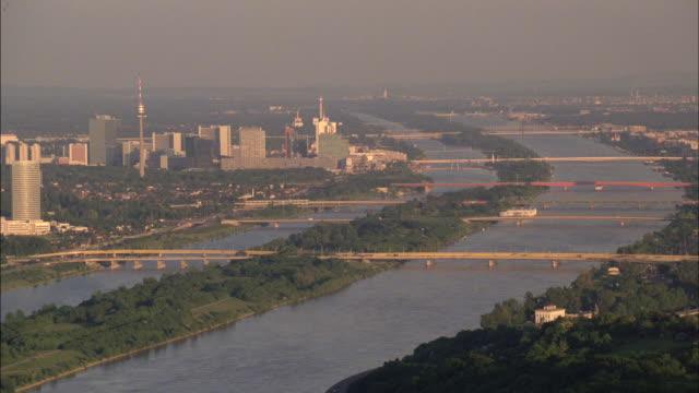 bridges span the danube river in vienna, austria. - river danube stock videos & royalty-free footage