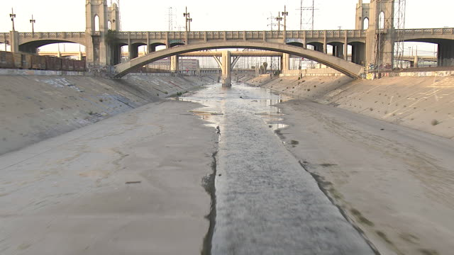 bridges span the shallow los angeles river. - underpass stock videos & royalty-free footage