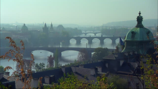 bridges span the vltava river in prague, czech republic. - river vltava stock videos & royalty-free footage