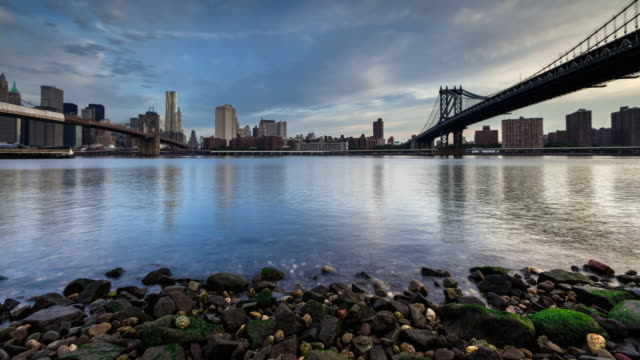 bridges to manhattan at sunrise - time lapse - brooklyn bridge stock videos & royalty-free footage