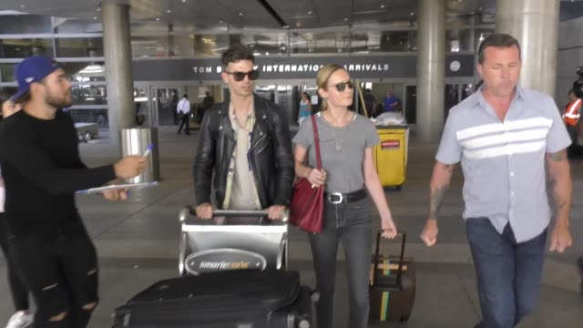 brie larson alex greenwald arriving at lax airport in los angeles in celebrity sightings in los angeles - brie larson stock videos and b-roll footage