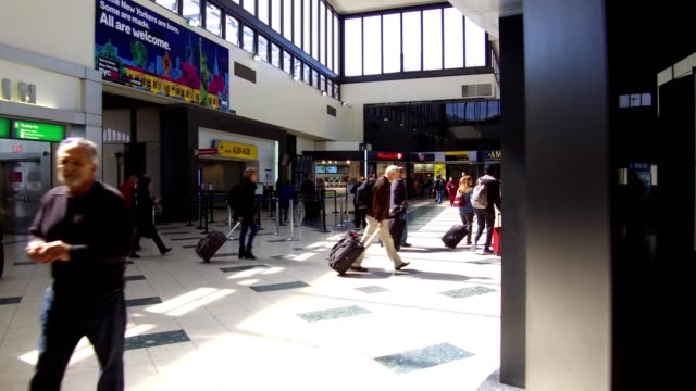 Brief dolly shot walking through Newark International Airport Newark New Jersey March 22 2018