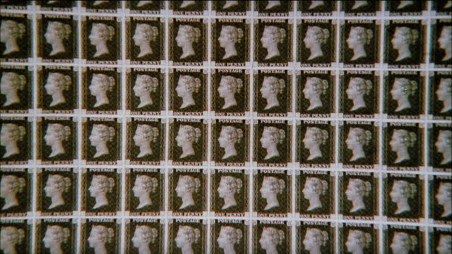 montage a brief history of british postage stamp designs / united kingdom - briefmarke stock-videos und b-roll-filmmaterial